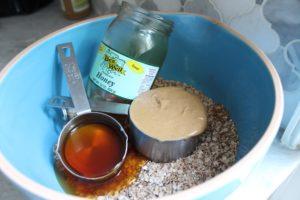 adding wet ingredients to bowl